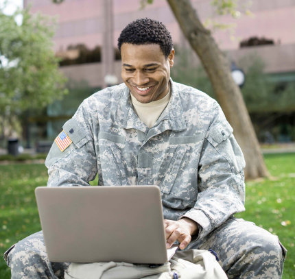 military personnel on his laptop